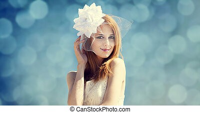 Young bride at blue sky background Photo with bokeh at...
