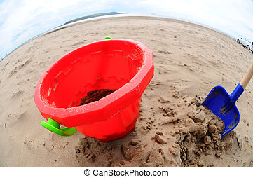 Bucket and Spade - close up wide angle shot of a toy bucket...