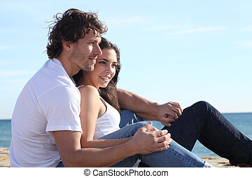Man and woman couple flirting in the beach
