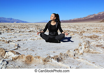 Death Valley - The beautiful girl sits in Bad water Salt...