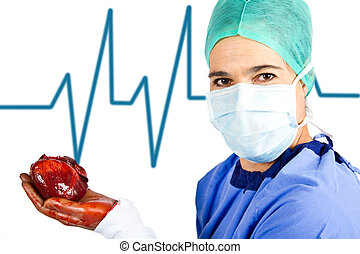 Medical doctor holding a heart in her hand with an ECG...