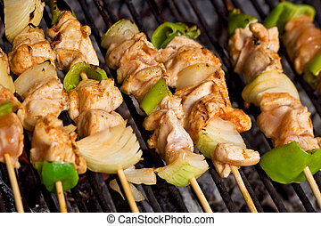Meat and vegetables on barbecue sticks - closeup - Barbecue...