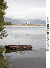 Isle Ornsay Lighthouse; Isle of Skye; Scotland with Boat in Foreground
