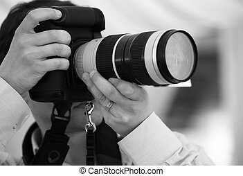 Photographer - The photographer with the cameras makes the...