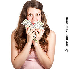 Joyful teenage girl with dollars in her hands Studio shot...