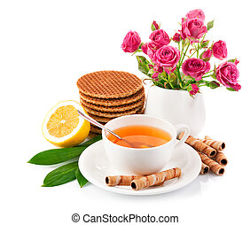 tea in cup with biscuits and lemon isolated on white...