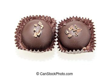 Two Dark Chocolate Truffles Isolated