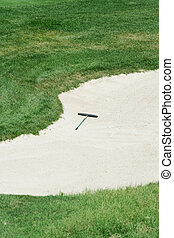 Golf rake in a sand trap