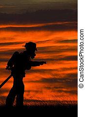 Burning fields - Fireman in the field