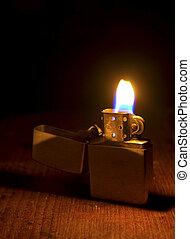 Burning lighter on dark background