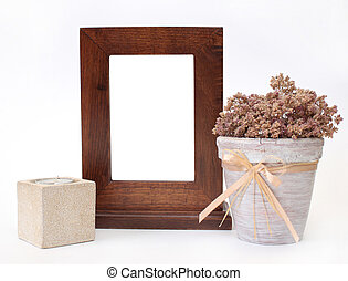Wooden frame, candlestick and flower pot. Object over white