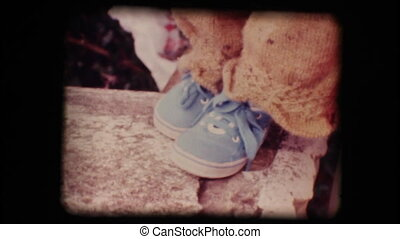 Vintage 8mm. Shoes of a little baby