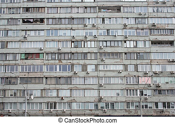 dull flat fasade of the old house of the Soviet period -...