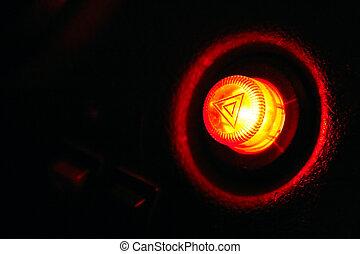 Burning car emergency button at night - as danger symbol