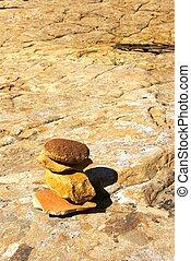 Cairn - Small cairn marking a trail across desert slickrock.
