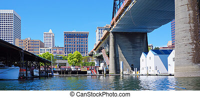 Tacoma downtown city marina with houses and large bridge. -...