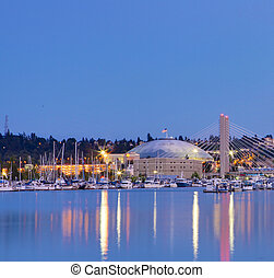Tacoma dome with boats and Marina City downtown at night
