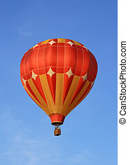 Orange hot air baloon - Red and orange hot air balloon in...