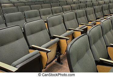 Auditorium seats in a college classrom setting.