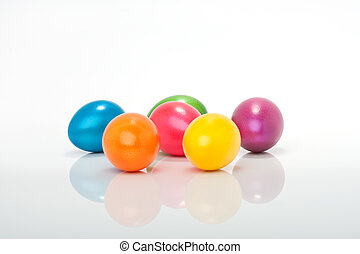 lot of colorful easter eggs isolated against white...