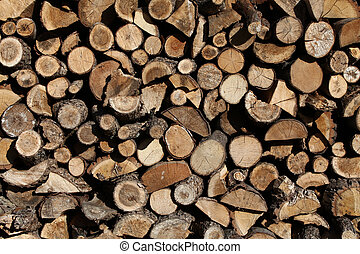 firewood arranged by the country cottage