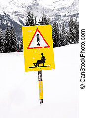 Sled route sign - Sled route warning sign in the mountains