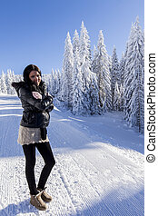 Young woman on winter vacation