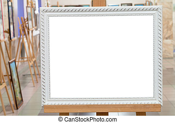 white picture frame on easel in art gallery hall - white...