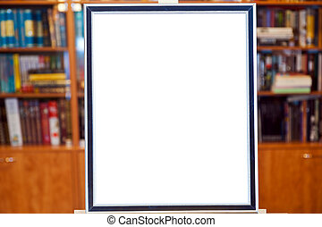 white canvas of picture frame on easel in library