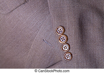 fragment of wool men's suit close up - tailor background -...