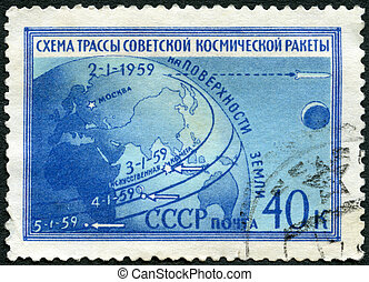 USSR - CIRCA 1959: A stamp printed in USSR shows Globe and route of Luna 1, the scheme of a line of the Soviet space rocket on an earth surface, circa 1959
