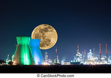 Oil refinery colored lights with moon at night
