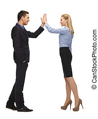 man and woman giving a high five - bright picture of man and...