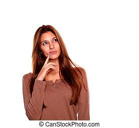 Pensive young woman looking up copyspace