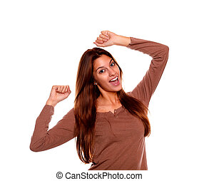 Happy young woman celebrating a victory