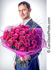 Proposal scene - Valentines day Man holding big bouquet of...