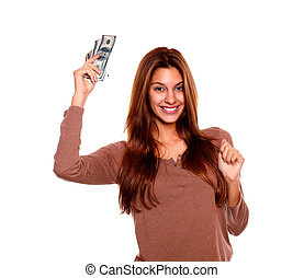 Happy young woman holding up cash money