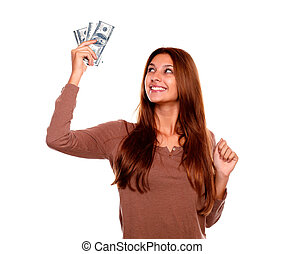 Smiling young woman holding up cash money - Portrait of a...