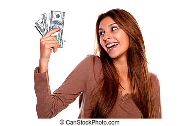 Smiling young female holding up cash money