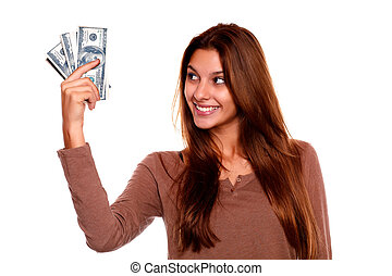 Young woman looking to right hand with cash money - Portrait...