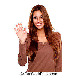 Young woman smiling and saying hello at you - Portrait of a...