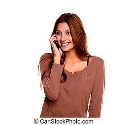 Smiling young woman speaking on cellphone - Portrait of a...