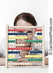 counting - young attractive woman using a wooden abacus to...