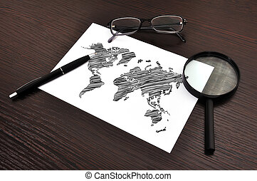 world map on paper - workplace with drawing world map on...