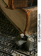movable type with old book - Typography workshop .Old...