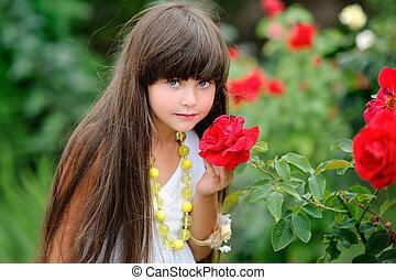 portrait of little girl outdoors in white sundress
