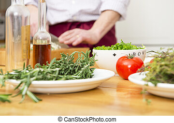 Culinary ingredients - Tomato, thyme, rosemary, onions and...