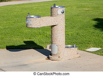 Concrete drinking fountain in park - Wheelchair accessible...