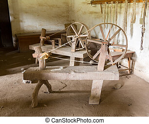Old spinning wheels in spanish mission - Old spinning wheel...