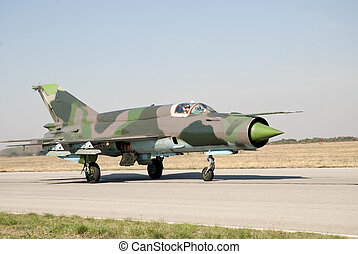 Mig 21 on the airfield  - Fighter plane in action